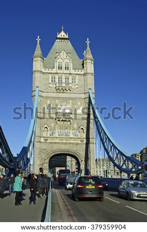 LONDON, UNITED KINGDOM - JANUARY 15: Unidentified people and traffic on Tower Bridge, landmark and tourist attraction, on January 15, 2016 in London, England