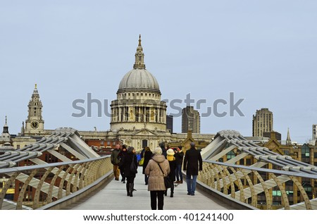 LONDON, UNITED KINGDOM - JANUARY 17: Unidentified people on Millennium bridge with St. Paul's cathedral behind, on January 17, 2016 in London, England