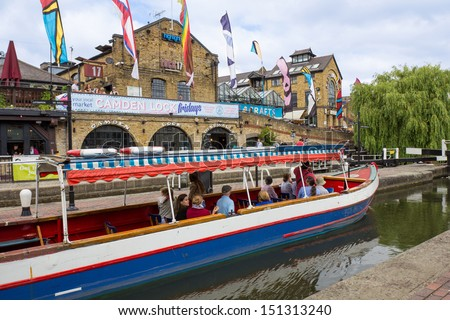 LONDON, UNITED KINGDOM - JULY 20: Camden Lock and Regent's Canal in Camden Town, London's most popular open-air market area on July 20, 2013 in London. - stock photo