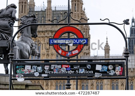 LONDON, UNITED KINGDOM - JULY 8, 2016: London underground sign at Westminster Bridge covered with stickers from around the world.