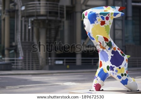 LONDON, UNITED KINGDOM - JULY 28, 2012:  Mascot for the 2012 London Olympic games with the modern architecture of the Lloyds of London building in the background. - stock photo