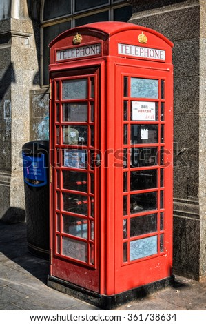 London, United Kingdom - July 23, 2012: Traditional english phone booth in London Chinatown as seen on 23rd of July, 2012. - stock photo