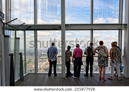LONDON, UNITED KINGDOM - JULY 2, 2014: Visitors enjoying the great view from the open-air public viewing platform of the Shard Building.