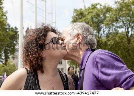London, United Kingdom - June 10, 2016: A Kissing Chain Event was held in Parliament Square in London to celebrate love not hate, to show support for the Remain campaign and to remember Jo Cox, MP.