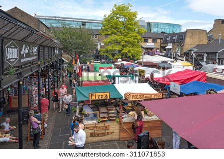 LONDON, UNITED KINGDOM - JUNE 17, 2015: Camden Town Market, famous alternative culture shops in Camden Town, London, England. Camden Town markets are visited by 100,000 people each weekend.
