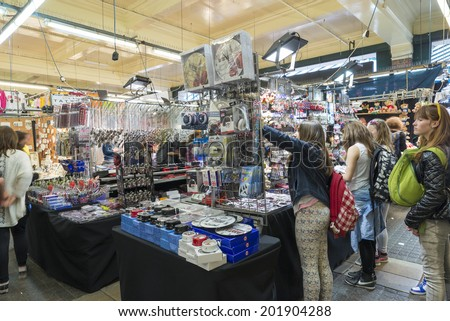 LONDON, UNITED KINGDOM - JUNE 5,  2014: Customers and vendors of souvenirs and knick Jubilee Market, near Covent Garden, London - stock photo
