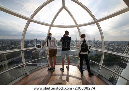 LONDON, UNITED KINGDOM - June 23: Detail of London Eye's cabins on June 23, 2014 in London, UK. London Eye is the tallest Ferris wheel in Europe at 135 meters. - stock photo