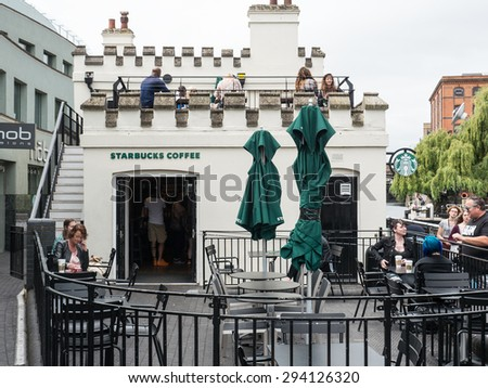 LONDON, UNITED KINGDOM - JUNE 2015: Starbucks store. Starbucks is the largest coffeehouse company in the world. - stock photo