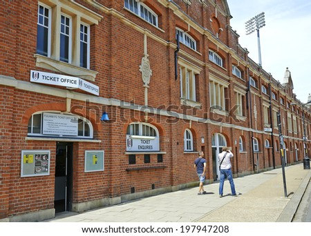 LONDON, UNITED KINGDOM - JUNE 06: Tickets office from the stadium of Fulham FC, two mans walking on June 06, 2014 in London.