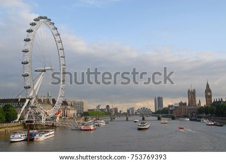 London, United Kingdom - June 13, 2015: View of London Eye, Southwark, Palace of Westminster and Big Ben at sunset from Golden Jubilee Bridges