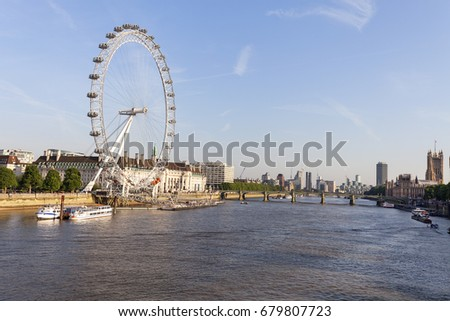 LONDON, UNITED KINGDOM - JUNE 21, 2017: View on London Eye on a sunny day. It was erected in 1999, is the most popular paid tourist attraction in the UK with over 3.75 million visitors annually