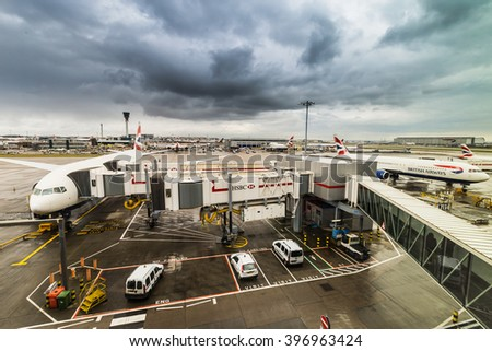 London, United Kingdom - March 5, 2016: British Airways jumbo jet aeroplanes at Heathrow Terminal 5 on a stormy day.British Airways is the largest airline in the United Kingdom. - stock photo
