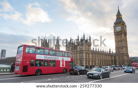 LONDON, UNITED KINGDOM - MARCH 8, 2015: Westminster palace and Big Ben and traffic on Westminster bridge in foreground