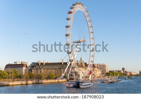 LONDON, UNITED KINGDOM - MAY 10: London Eye in afternoon sun on May 10, 2011 in London. The giant Ferris wheel is 135 meters tall and the wheel has a diameter of 120 meters.