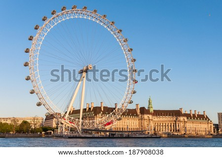 LONDON, UNITED KINGDOM - MAY 10: London Eye in afternoon sun on May 10, 2011 in London. The giant Ferris wheel is 135 meters tall and the wheel has a diameter of 120 meters. - stock photo