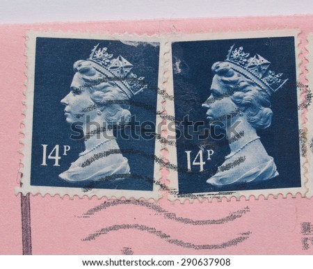 LONDON, UNITED KINGDOM - MAY 23, 2015: Stamps printed by United Kingdom bearing the portrait of the Queen over a pink envelope - stock photo