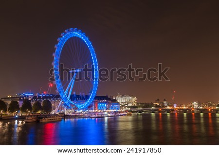 LONDON, UNITED KINGDOM - NOVEMBER 10, 2014: Night view of the South Bank of the River Thames including the world famous landmark, London Eye. - stock photo