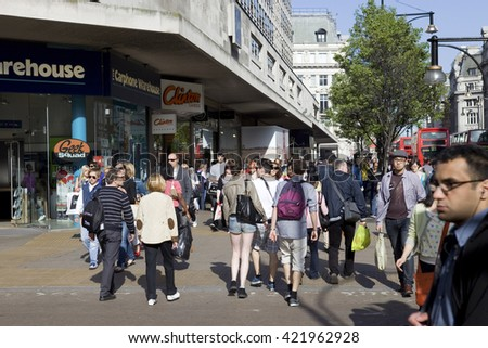 LONDON, UNITED KINGDOM - OCTOBER 16, 2015: Crowded sidewalk on Oxford Street with tourists from all over the world. - stock photo