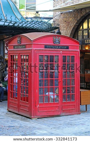 LONDON, UNITED KINGDOM - OCTOBER 10, 2010: Information Kiosk at Stables Market in Camden Town. Oversized Red Telephone Box Upcycled in The Stables, London, England.