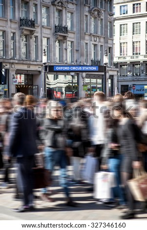 LONDON, UNITED KINGDOM â?? OCTOBER 01 2015. Rush hour in London around Oxford Circus underground station. Oxford Circus has London's highest pedestrian volumes - stock photo