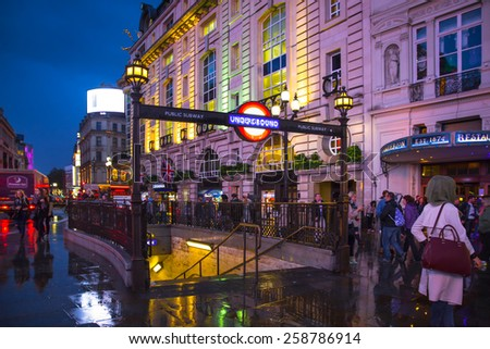 LONDON, UNITED KINGDOM - OCTOBER 8, 2014:  View of London Piccadilly Circus West End district seen at night with people and Underground station in view. - stock photo