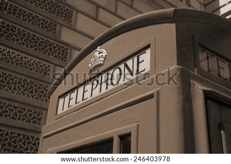 London, United Kingdom - red telephone box close-up. Sepia tone - filtered retro style monochrome photo. - stock photo