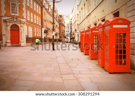 London, United Kingdom - red telephone boxes of Broad Court, Covent Garden. Retro photo filtered style. - stock photo
