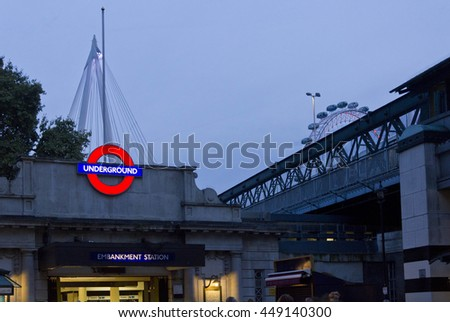 LONDON, UNITED KINGDOM - SEPTEMBER 11 2015: Embakment metro station at twilight in London, with millenium wheel in the background