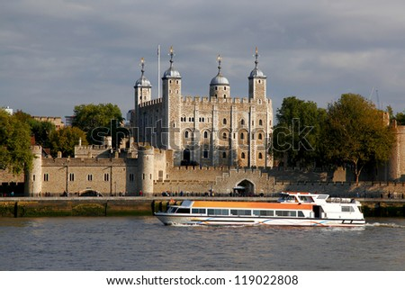 London with Tower Hill old castle against city cruise, England - stock photo