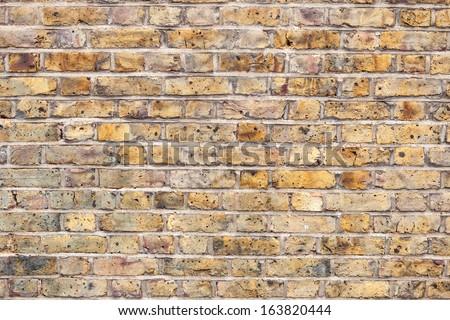 London yellow brick wall - stock photo