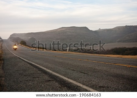 Lone Biker on an Empty Highway