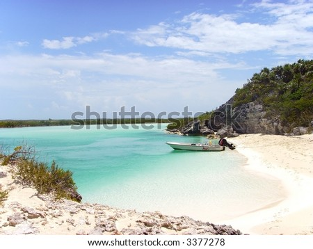 Lone Boat on a Deserted Beach Island in the Bahamas...