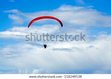 Lone Hang Glider in a cloudy sky