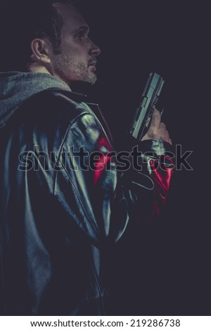 Lone man armed with a pistol, robber - stock photo