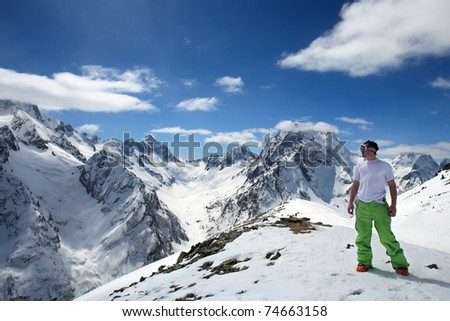 Lone man in a beautiful mountain landscape of the Caucasus Mountains Dombai
