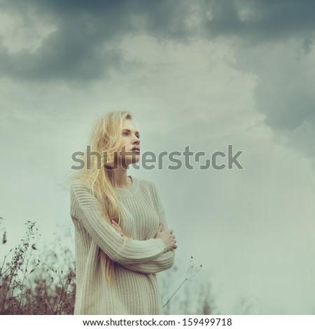 Lone sad beautiful girl outdoors - stock photo