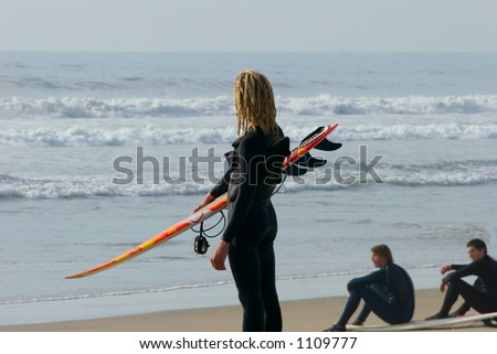 Lone surfer watching waves - stock photo