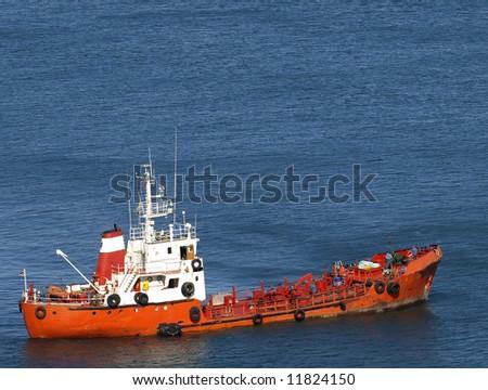 Lone trawler in the Mediterranean Sea in Malta - stock photo
