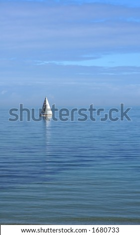 Lone yacht sailing on pastel-blue sea