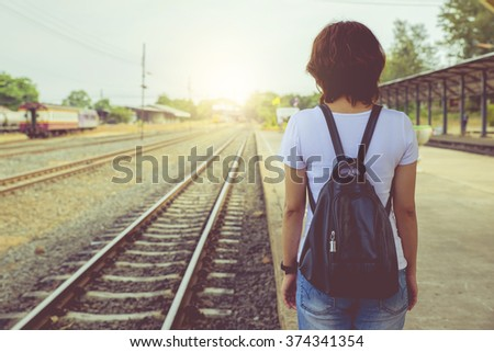 Loneliness Alone Boredom Awaited Hope woman at the train station. vintage - stock photo