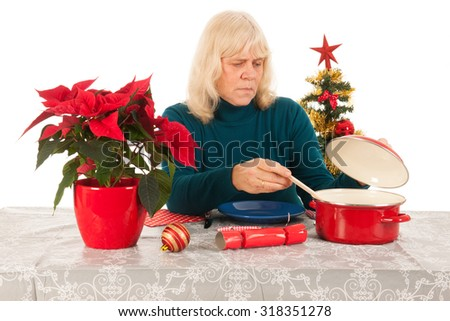 Loneliness in Christmas time for a senior woman - stock photo