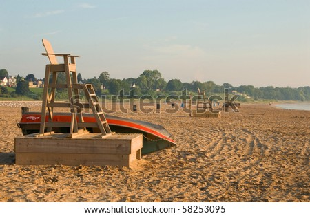 Lonely beach in the early morning sun. - stock photo