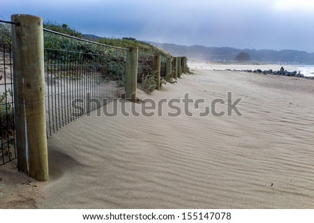 Lonely beach in winter time - stock photo