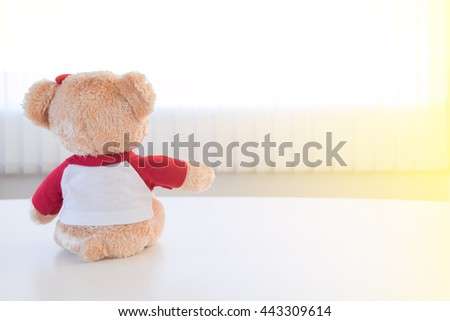 lonely bear toy reach arm for love and care - stock photo