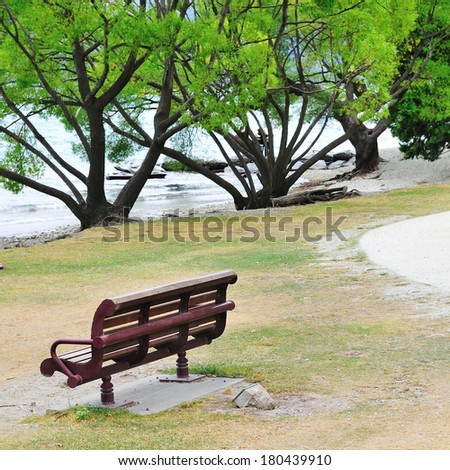 lonely bench by the lake - nobody outdoor park day concept tranquil empty lonely scenery nature
