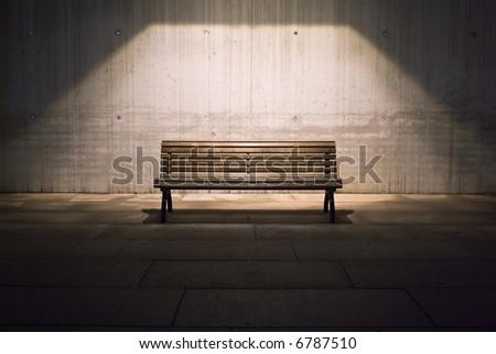 lonely bench in spotlight - stock photo