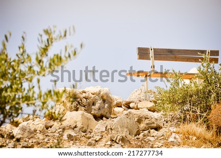 Lonely bench on the white stones - stock photo