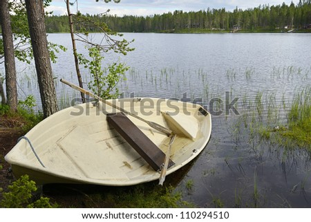 Lonely boat after rain. Northern Finland