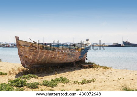 Lonely Boat at Summer Time on the Beach in Greece.