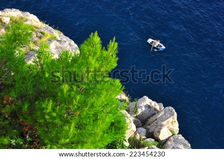 Lonely boat near the land - stock photo